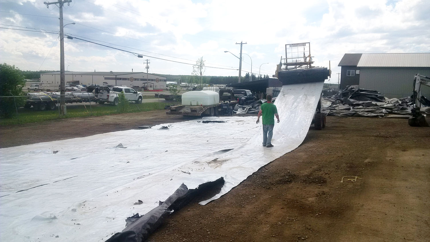 LLDPE liner sheet laid out and sliced into 6′ wide strips