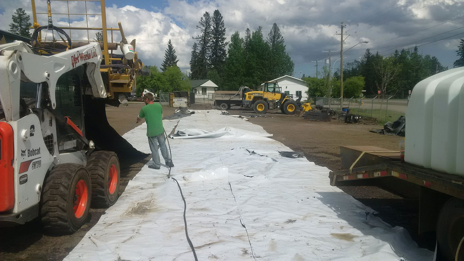 Washing remaining debris off the LLDPE strip while rolling it